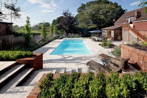 Surrey swimming pool gardens for Gardens around pools